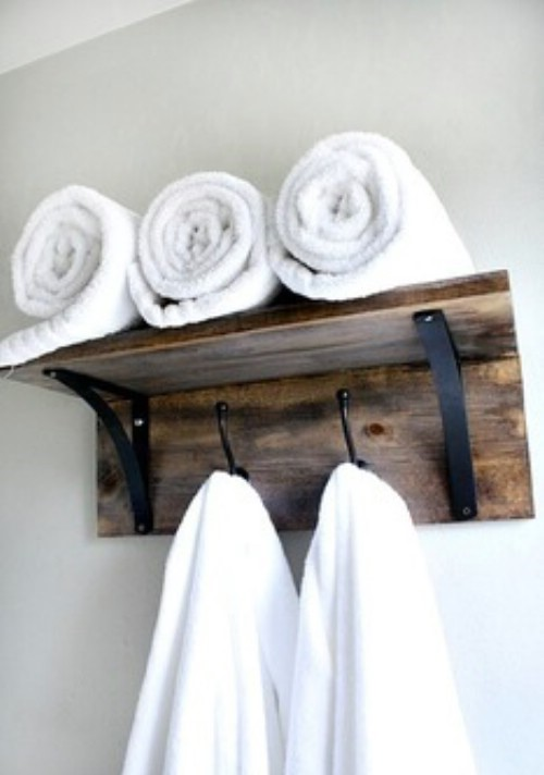 We have collected a list of 10 of the best DIY projects to give your home that rustic look. You can find everything from headboards and picture frames to cabinets and shelves made from wooden pallets.  Whatever your dream for a rustic look, you are sure to find something in this collection that will help you along. Many of these projects are so easy to do and you can complete them in less than a day. Some make wonderful gifts as well so if you know someone else who just loves the country, rustic look, make them something to brighten their own décor. The projects use all sorts of materials, many of which are really inexpensive or even cheap in some cases. 1.	Wooden Coffee Cup Hanger An old piece of wood and a few hooks will help you to create a beautiful hanger for your favorite coffee cups. 2.	Wooden Towel Organizer A couple of pieces of wood and some cute hangers will give you a great rustic towel rack for the bathroom. 3.	Mason Jar Sconces You can do so much with Mason jars. Take this sconce idea for instance. 4.	Tree Trunk Coffee Tables You really don't have to do anything to get a great set of coffee tables. 5.	Rustic Toilet Paper Holder       Old steel pipe and a strip of wood work together beautifully to create a rustic toilet paper holder that is sure to be the hit of your bathroom. 6.	Wooden Slab Mud Room Bench A large wooden slab would make a wonderful bench for your mud room. 7.	Rustic Herringbone Dresser You can create a dramatic focal point in any room by simply painting an old dresser in a rustic herringbone design. If you don't have an old wooden dresser, you can usually get them pretty cheap at flea markets and yard sales. 8.	Wooden Jewelry Hanger With a few branches or pieces of driftwood, you can create a beautiful jewelry holder for necklaces and bracelets.  9.	Redone Rustic Cabinet If you have an old cabinet or dresser that you can redo, consider taking out the drawers and just adding rustic wooden planks.  10.	Tree Branch Privacy Screen Whether you really need your privacy or you just want to add a bit of rustic charm to your home, this tree branch privacy screen is a great DIY project.